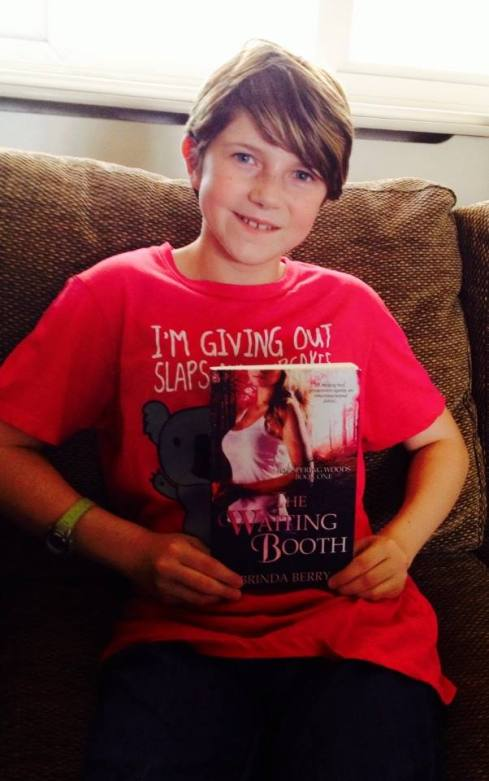 Evie with her signed copy of The Waiting Booth